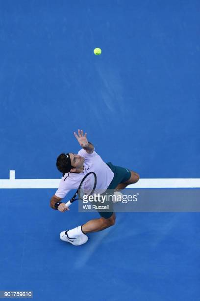 Roger Federer of Switzerland serves to Alexander Zverev of Germany in the mens singles match on Day Eight of the 2018 Hopman Cup at Perth Arena on...