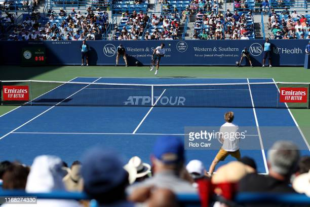 Roger Federer of Switzerland serves to Andrey Rublev of Russia during Day 6 of the Western and Southern Open at Lindner Family Tennis Center on...