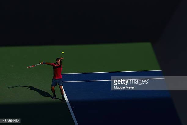 Roger Federer of Switzerland serves to Andy Murray of Great Britain during the semifinals on Day 8 of the Western Southern Open at the Lindner Family...
