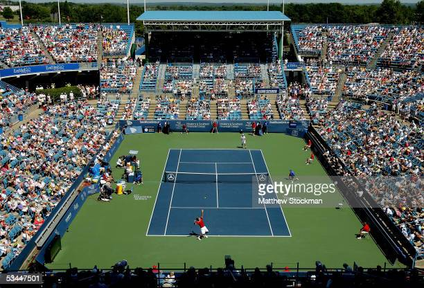 Roger Federer of Switzerland serves to Andy Roddick during the final of the Western & Southern Financial Group Masters on August 21, 2005 at the...