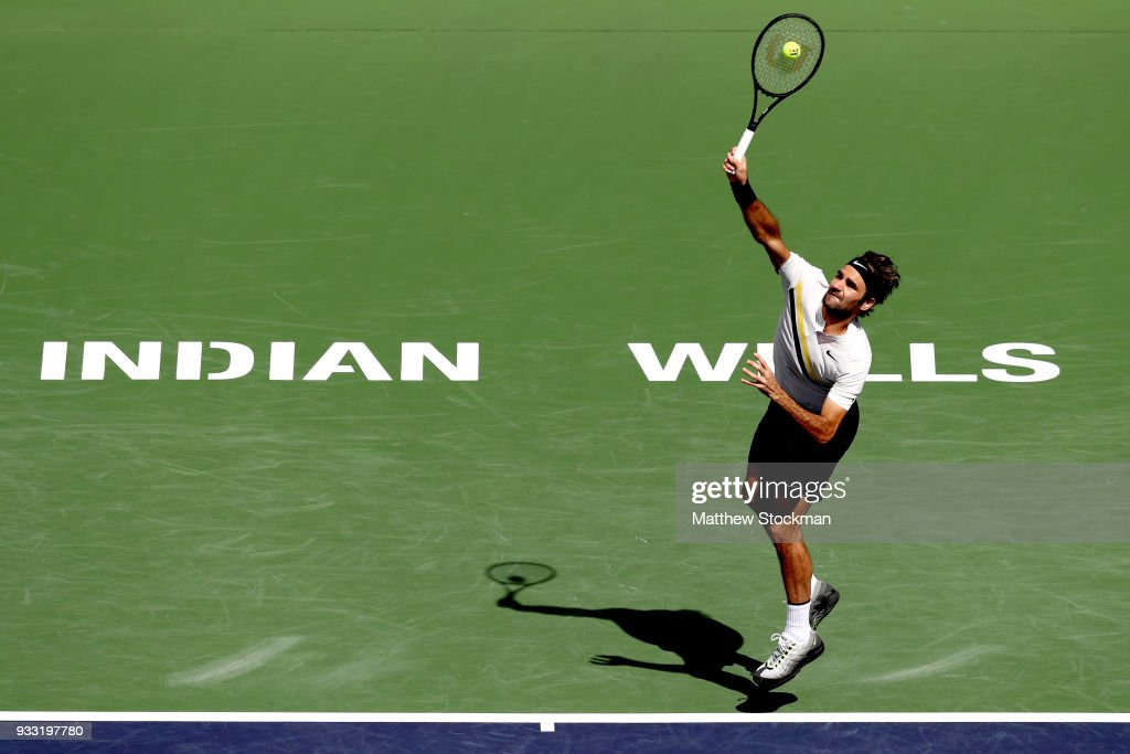 Roger Federer of Switzerland serves to Borna Coric of Croatia during the semifinal match on Day 13 of the BNP Paribas Open at the Indian Wells Tennis Garden on March 17, 2018 in Indian Wells, California.