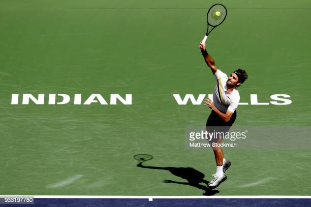 Roger Federer of Switzerland serves to Borna Coric of Croatia during the semifinal match on Day 13 of the BNP Paribas Open at the Indian Wells Tennis...