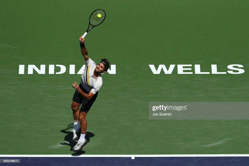 Roger Federer of Switzerland serves to Borna Coric of Croatia during the semifinal match at BNP Paribas Open - Day 13 on March 17, 2018 in Indian Wells, California.