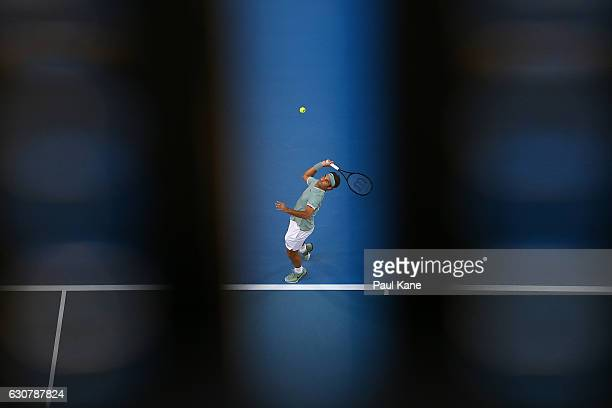 Roger Federer of Switzerland serves to Dan Evans of Great Britain in the men's singles match on day two of the 2017 Hopman Cup at Perth Arena on...