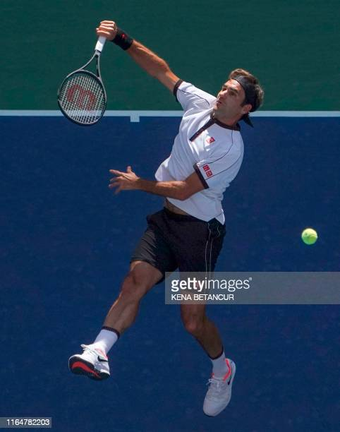 Roger Federer of Switzerland serves to Daniel Evans of Great Britain during their Round Three Men's Singles match at the 2019 US Open at the USTA...