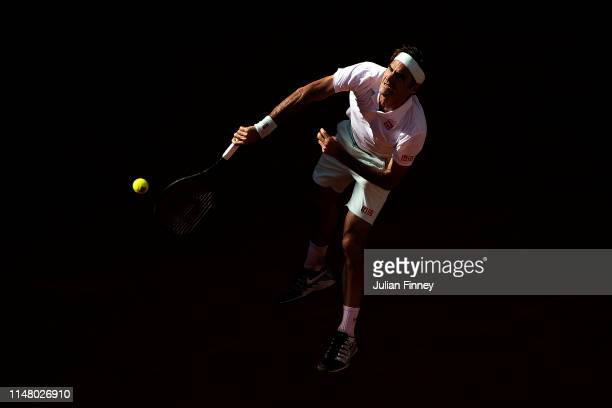 Roger Federer of Switzerland serves to Gael Monfils of France during day six of the Mutua Madrid Open at La Caja Magica on May 09, 2019 in Madrid,...