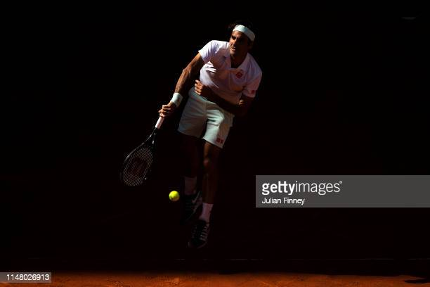 Roger Federer of Switzerland serves to Gael Monfils of France during day six of the Mutua Madrid Open at La Caja Magica on May 09 2019 in Madrid Spain