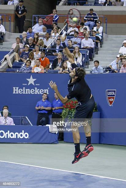 Roger Federer of Switzerland serves to Gael Monfils of France during their men's singles quarterfinal tennis match on Day 11 of the 2014 US Open at...