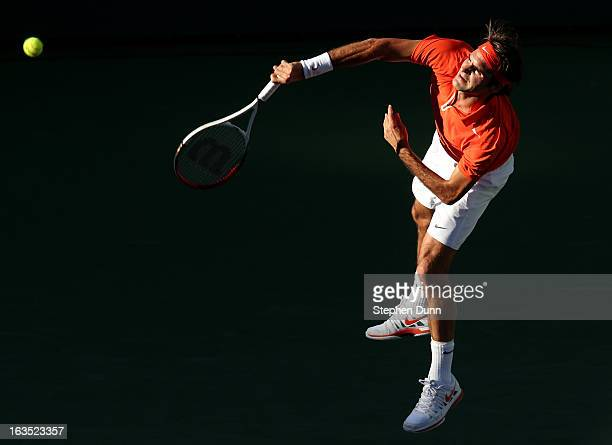 Roger Federer of Switzerland serves to Ivan Dodig of Croatia during day 6 of the BNP Paribas Open at Indian Wells Tennis Garden on March 11, 2013 in...