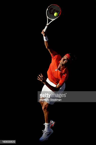 Roger Federer of Switzerland serves to Ivan Dodig of Croatia during the BNP Paribas Open at the Indian Wells Tennis Garden on March 11 2013 in Indian...