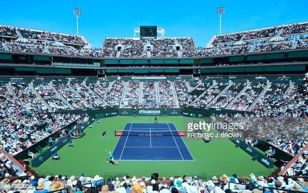 Roger Federer of Switzerland serves to Jack Sock of the US in their men's semifinal at the ATP Indian Wells Masters in Indian Wells, California on...