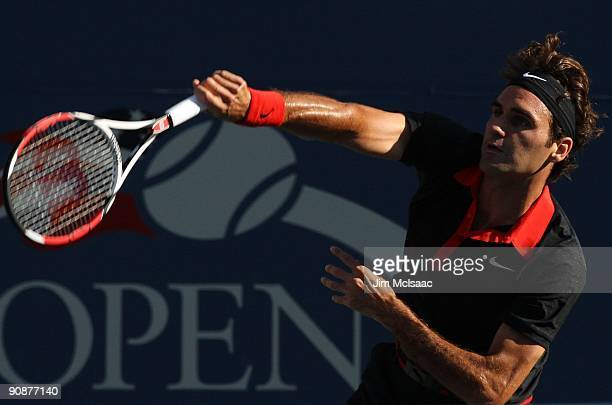 Roger Federer of Switzerland serves to Juan Martin Del Potro of Argentina during the Men's Singles final on day fifteen of the 2009 US Open at the...