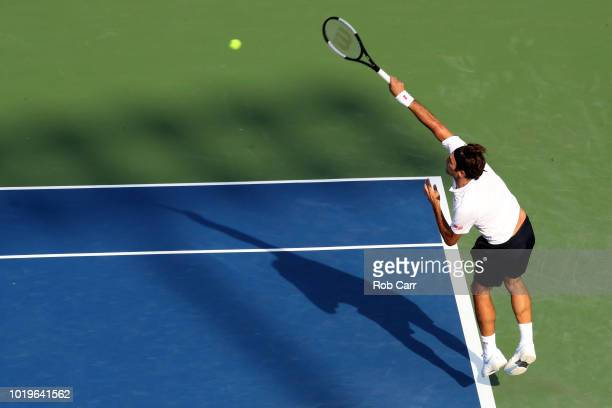 Roger Federer of Switzerland serves to Novak Djokovic of Serbia in the mens final during Day 9 of the Western and Southern Open at the Lindner Family...