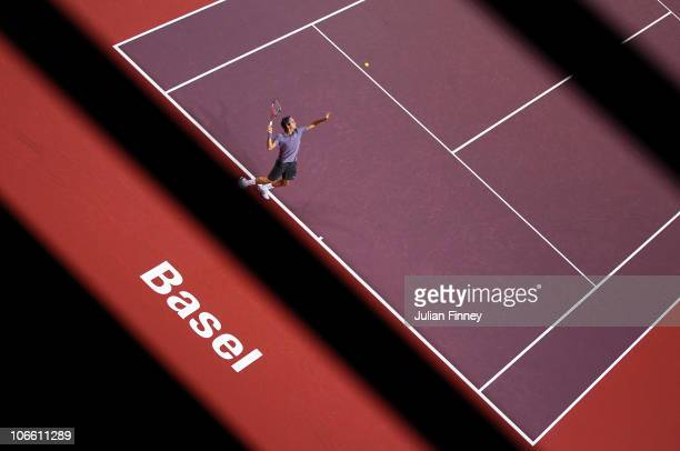 Roger Federer of Switzerland serves to Novak Djokovic of Serbia in the final during Day Seven of the Davidoff Swiss Indoors Tennis at St Jakobshalle...