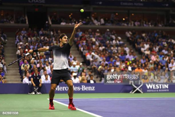 Roger Federer of Switzerland serves to Philipp Kohlschreiber of Germany during their men's singles fourth round match on Day Eight of the 2017 US...