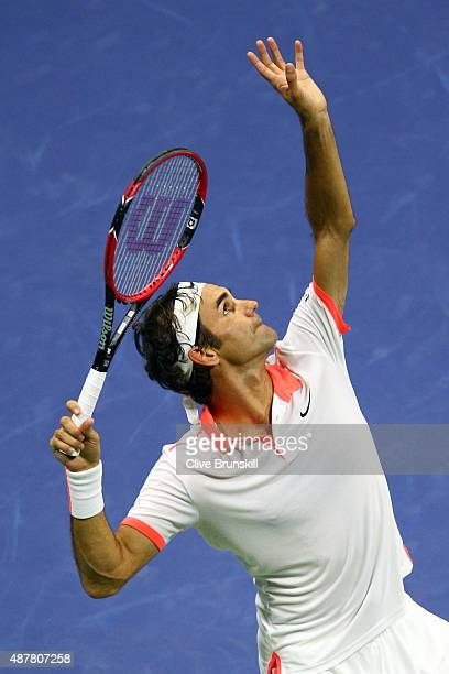 Roger Federer of Switzerland serves to Stan Wawrinka of Switzerland during their Men's Singles Semifinals match on Day Twelve of the 2015 US Open at...