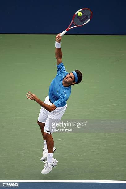 Roger Federer of Switzerland serves to Tim Henman of England during the US Open at the USTA Billie Jean King National Tennis Center in Flushing...