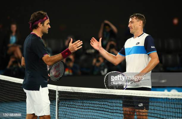 Roger Federer of Switzerland shakes hands at the net after his five set victory in his Men's Singles third round match against John Millman of...