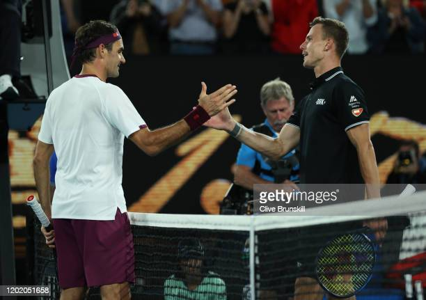 Roger Federer of Switzerland shakes hands at the net after his four set victory in his Men's Singles fourth round match against Marton Fucsovics of...