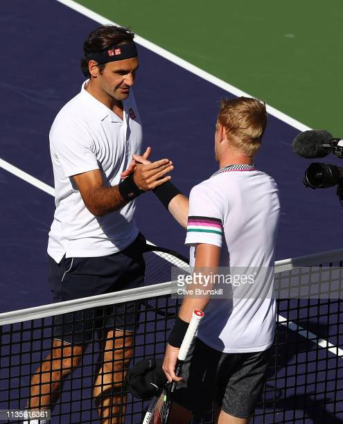 Roger Federer of Switzerland shakes hands at the net after his straight sets victory against Kyle Edmund of Great Britain during their men's singles...