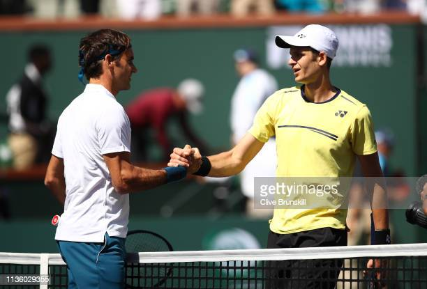 Roger Federer of Switzerland shakes hands at the net after his straight sets victory against Hubert Hurkacz of Poland during their men's singles...