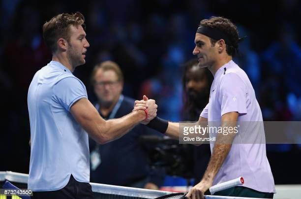 Roger Federer of Switzerland shakes hands at the net after his straight sets victory against Jack Sock of the United States during the Nitto ATP...