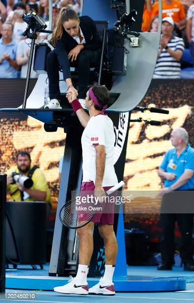 Roger Federer of Switzerland shakes hands with chair umpire Marijana Veljovic after his Men's Singles Quarterfinal match against Tennys Sandgren of...