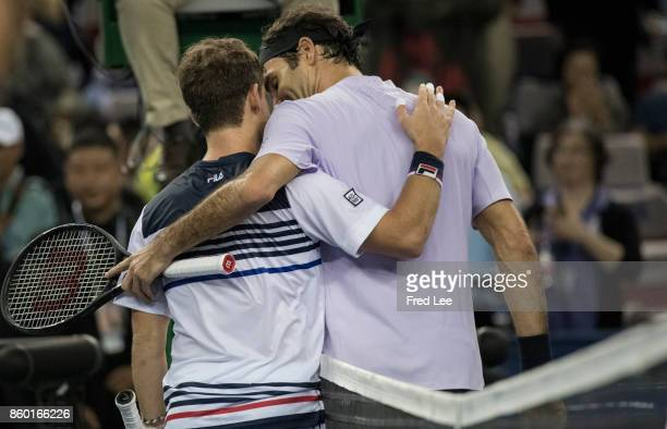 Roger Federer of Switzerland shakes hands with Diego Schwartzman of Argentina after their Men's singles mach against on day 4 of 2017 ATP Shanghai...