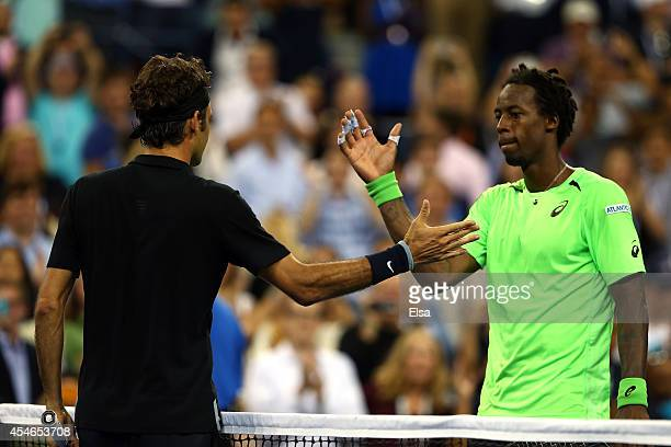 Roger Federer of Switzerland shakes hands with Gael Monfils of France after their men's singles quarterfinal match on Day Eleven of the 2014 US Open...