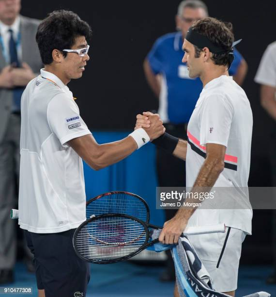 Roger Federer of Switzerland shakes hands with his opponent Hyeon Chung of South Korea as he retires injured in their semi final on day 12 of the...