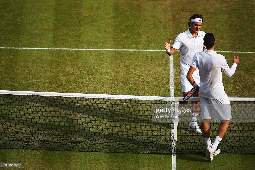 Roger Federer of Switzerland shakes hands with Milos Raonic of Canada after their Gentlemen's Singles semi-final on day eleven of the Wimbledon Lawn Tennis Championships at the All England Lawn Tennis and Croquet Club on July 4, 2014 in London, England.