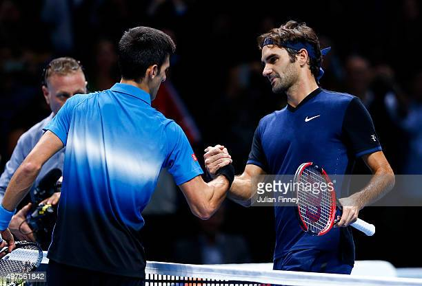 Roger Federer of Switzerland shakes hands with Novak Djokovic of Serbia after his straight sets victory during day three of the Barclays ATP World...