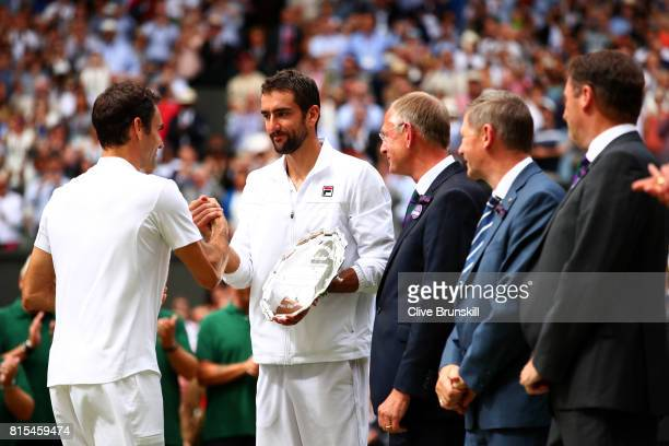Roger Federer of Switzerland shakes hands with runnerup Marin Cilic of Croatia after the Gentlemen's Singles final on day thirteen of the Wimbledon...