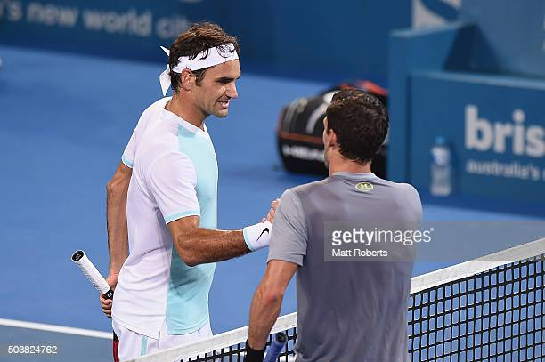 Roger Federer of Switzerland shakes hands with Tobias Kamke of Germany after their match during day five of the 2016 Brisbane International at Pat...