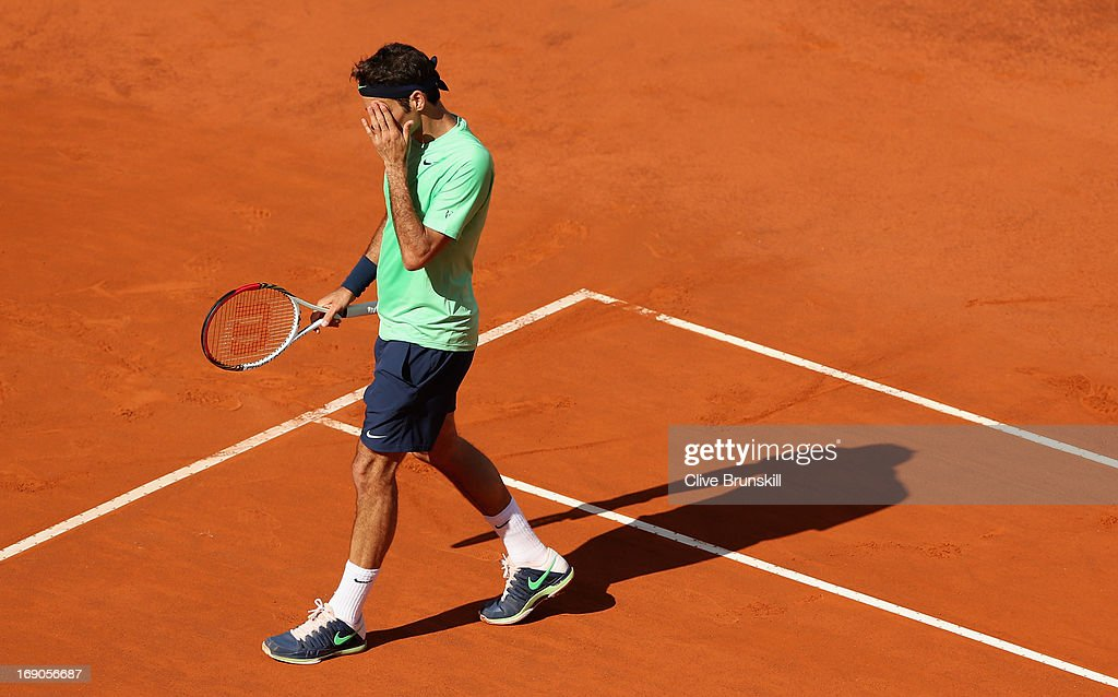 Roger Federer of Switzerland shows his dejection during his straight sets defeat against in their final match during day eight of the Internazionali BNL d'Italia 2013 at the Foro Italico Tennis Centre on May 19, 2013 in Rome, Italy.