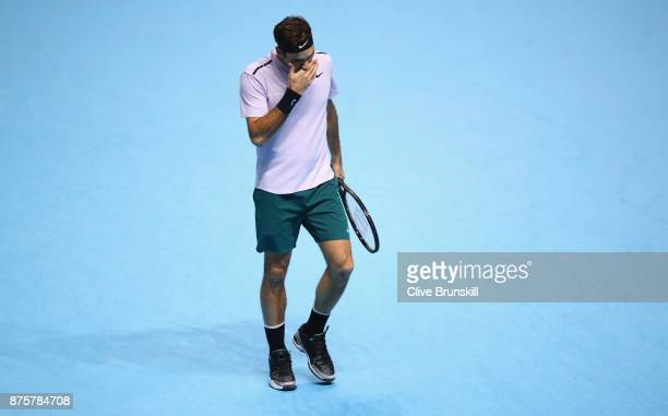 Roger Federer of Switzerland shows his dejection during his three set defeat by David Goffin of Belgium in their semi final match the Nitto ATP World...