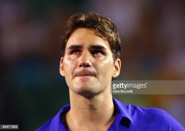 Roger Federer of Switzerland shows his emotion during the trophy presentation after his men's final match against Rafael Nadal of Spain during day...