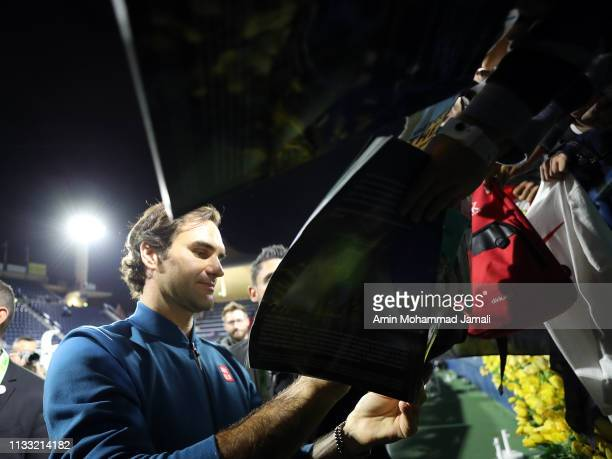 Roger Federer of Switzerland signs autographs after defeating Stefanos Tsitsipas of Greece in their final during day Fourteen of the Dubai Duty Free...