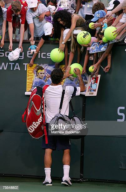 Roger Federer of Switzerland signs autographs after his loss to Guillermo Canas of Argentina during the Pacific Life Open on March 11, 2007 at the...
