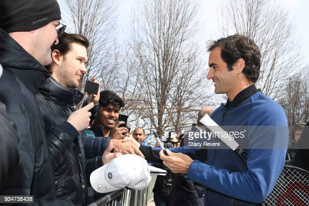 Roger Federer of Switzerland signs autographs for fans at Cloud Gate for the Laver Cup 2018 Chicago Launch on March 19 2018 in Chicago Illinois