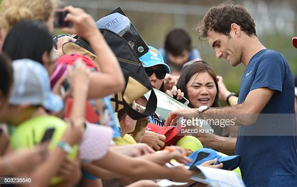 Roger Federer of Switzerland signs autographs for fans following a training session at the Brisbane International tennis tournament on January 3 2016...