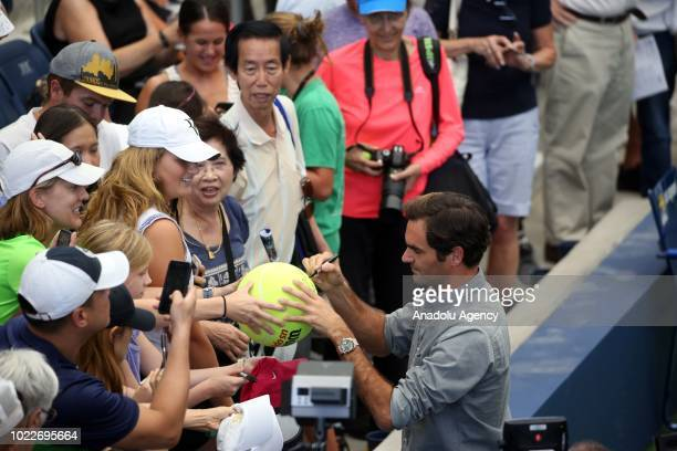 Roger Federer of Switzerland signs for fans after a press conference ahead of US Open 2018 tournament in Louis Armstrong Stadium in Flushing New York...