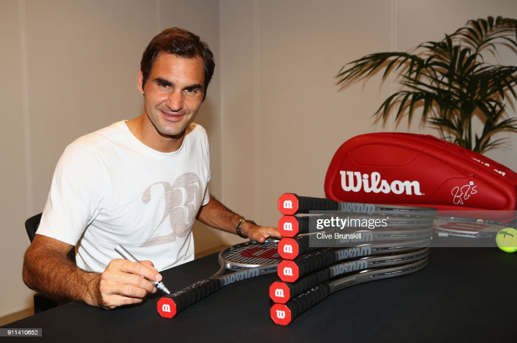 Roger Federer of Switzerland signs twenty Wilson Pro Staff commemorative tennis rackets to be sold for charity after winning his 20th grand slam title against Marin Cilic of Croatia on day 14 of the 2018 Australian Open at Melbourne Park on January 28, 2018 in Melbourne, Australia.