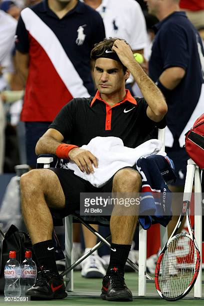 Roger Federer of Switzerland sits during a break in the fifth set against Juan Martin Del Potro of Argentina during the Men's Singles final on day...
