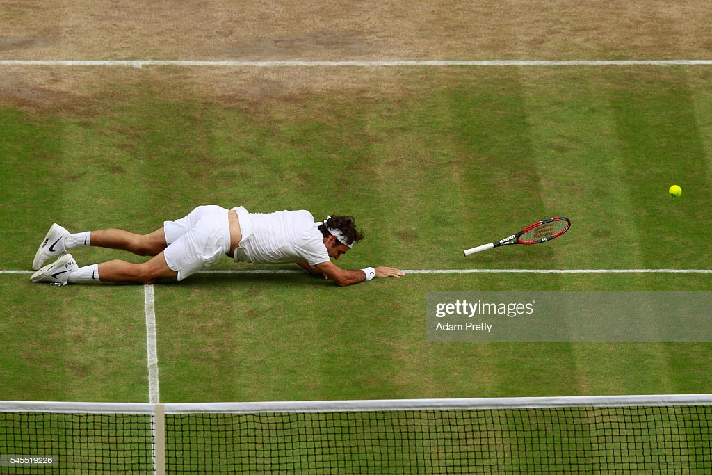 Roger Federer of Switzerland slips during the Men's Singles Semi Final match against Milos Raonic of Canada on day eleven of the Wimbledon Lawn Tennis Championships at the All England Lawn Tennis and Croquet Club on July 8, 2016 in London, England.