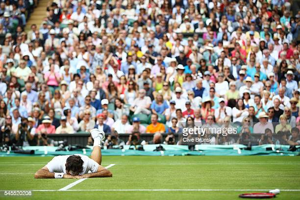 Roger Federer of Switzerland slips during the Men's Singles Semi Final match against Milos Raonic of Canada on day eleven of the Wimbledon Lawn...