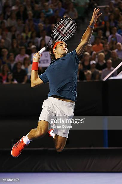Roger Federer of Switzerland smashes an attempted lob in his match against Jo Wilfried Tsonga of Francce during the Roger Federer Charity Match at...