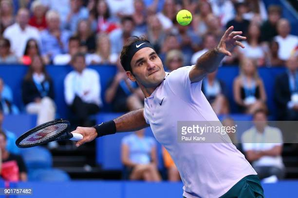 Roger Federer of Switzerland smashes the ball into the air after missing a shot during his singles finals match against Alexander Zverev of Germany...