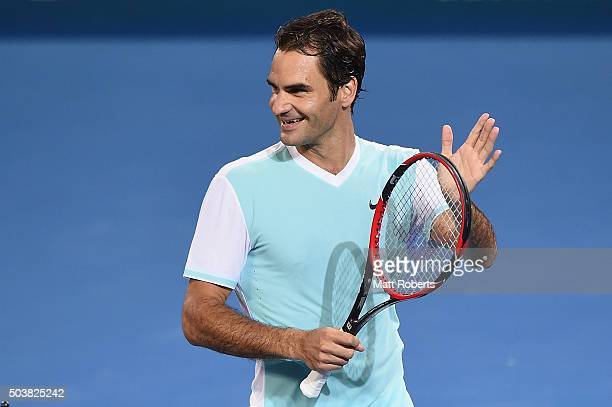 Roger Federer of Switzerland smiles after winning his match against Tobias Kamke of Germany during day five of the 2016 Brisbane International at Pat...