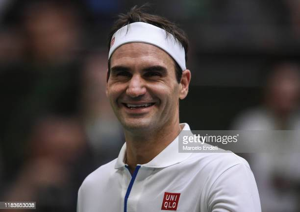 Roger Federer of Switzerland smiles during an exhibition game between Alexander Zverev and Roger Federer at Arena Parque Roca on November 20 2019 in...